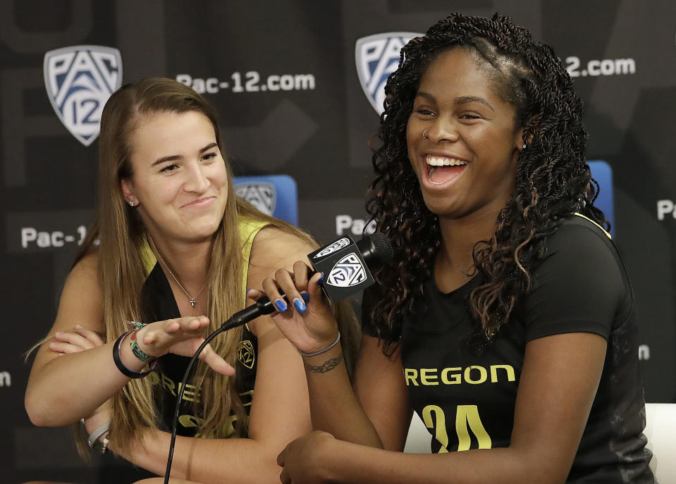 Oregon's Ruthy Hebard, right, speaks next to Sabrina Ionescu during NCAA college basketball Pac-12 media day in San Francisco, Wednesday, Oct. 10, 2018. (AP Photo/Jeff Chiu)