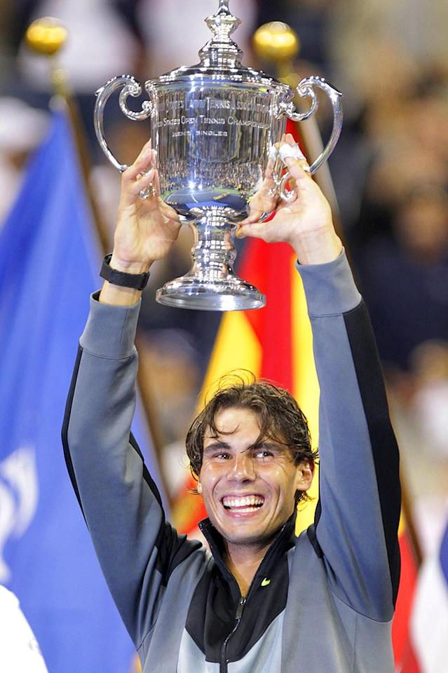 "Rafael Nadal was all smiles while hoisting up his trophy after winning his first U.S. Open. The Spanish tennis star beat Novak Djokovic in four sets, earning himself a career Grand Slam at age 24! Juan Soliz/<a href=""http://www.PacificCoastNews.com"" target=""new"">PacificCoastNews.com</a> - September 13, 2010"