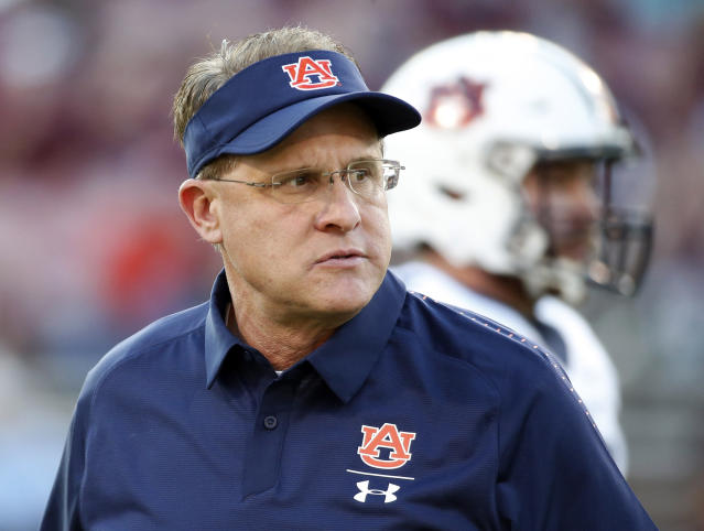 FILE - In this Oct. 6, 2018, file photo, Auburn coach Gus Malzahn watches players warm up before an NCAA college football game against Mississippi State in Starkville, Miss. The Tigers have been one of the most difficult teams in the country to predict in recent years. Fittingly, the same can be said of Malzahns long-term job security. (AP Photo/Rogelio V. Solis, File)