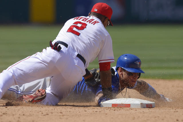 Toronto Blue Jays' Brett Lawrie dives back to second under the tag of Los Angeles Angels shortstop Erick Aybar during the ninth inning of their baseball game, Sunday, Aug. 4, 2013, in Anaheim, Calif. (AP Photo/Mark J. Terrill)