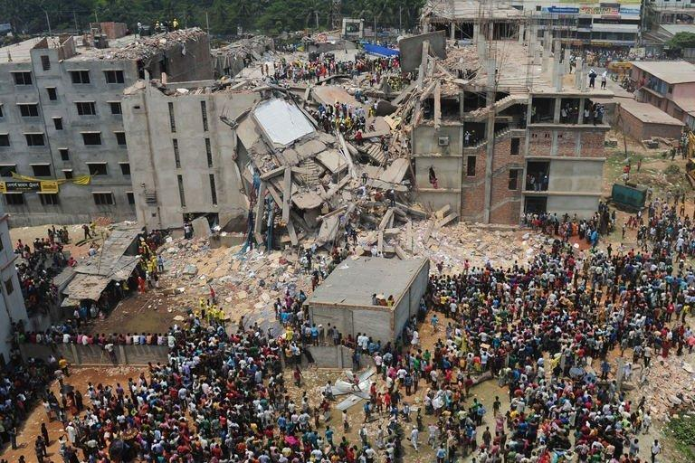 Bangladeshi volunteers and rescue workers at the scene of a building collapse in Savar, on the outskirts of Dhaka, on April 25, 2013