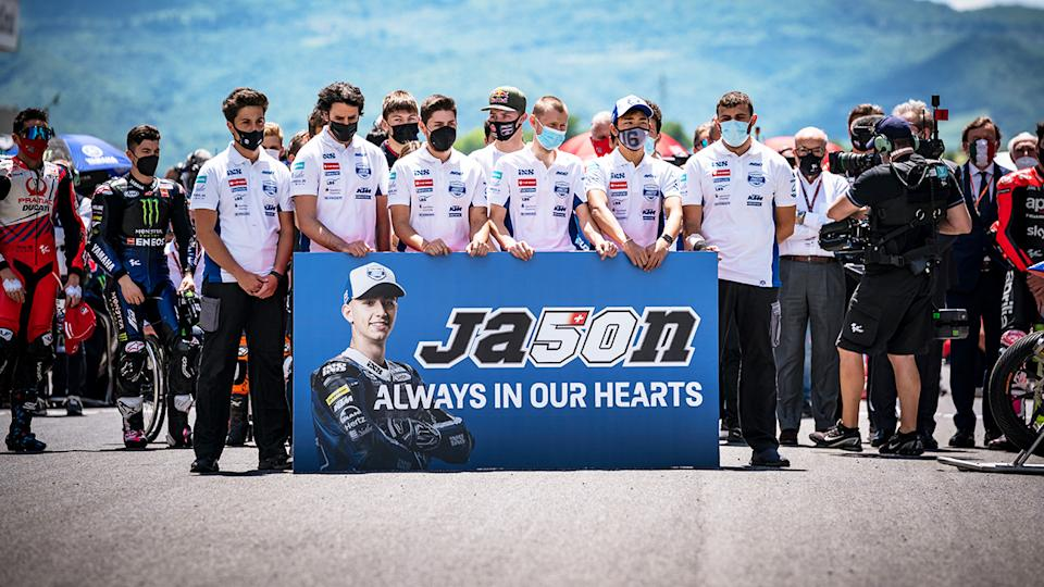 Fellow riders, pictured here holding a minute of silence on the starting grid in memory of Moto3 rider Jason Dupasquier.