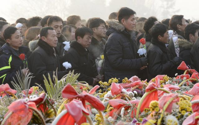 North Koreans offer flowers to bronze statues of North Korea's late founder Kim Il Sung and late leader Kim Jong Il at Mansudae in Pyongyang