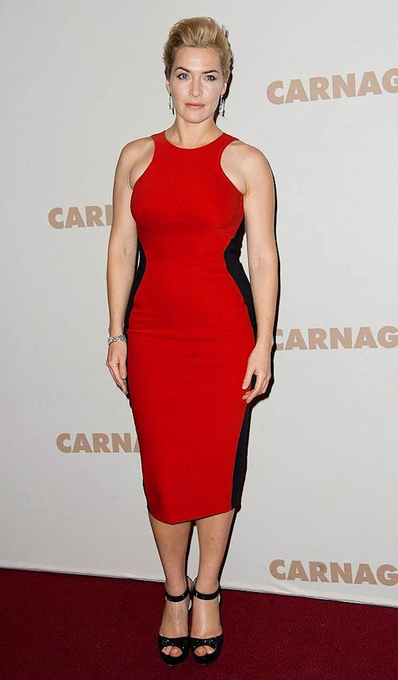 """Meanwhile, in Paris, Kate Winslet took to the red carpet for the premiere of her latest project, """"Carnage."""" The Oscar winner -- who could very well land another nom for her work in this film -- looked ravishing in a red Stella McCartney dress, chic updo, and black ankle-strap sandals. (11/20/2011)"""