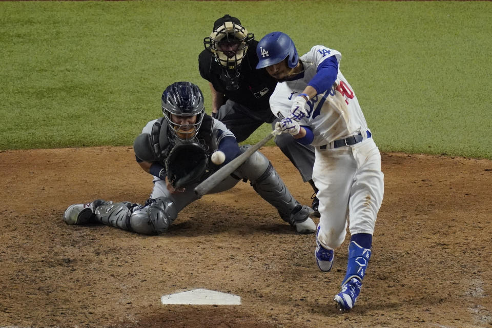 Los Angeles Dodgers' Mookie Betts hits a home run against the Tampa Bay Rays during the eighth inning in Game 6 of the baseball World Series Tuesday, Oct. 27, 2020, in Arlington, Texas. (AP Photo/Sue Ogrocki)