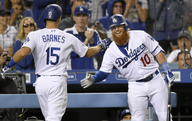 Los Angeles Dodgers' Austin Barnes,left, is congratulated by Justin Turner for his two-run home run during the fourth inning of a baseball game against the New York Mets on Tuesday, Sept. 4, 2018, in Los Angeles. (AP)
