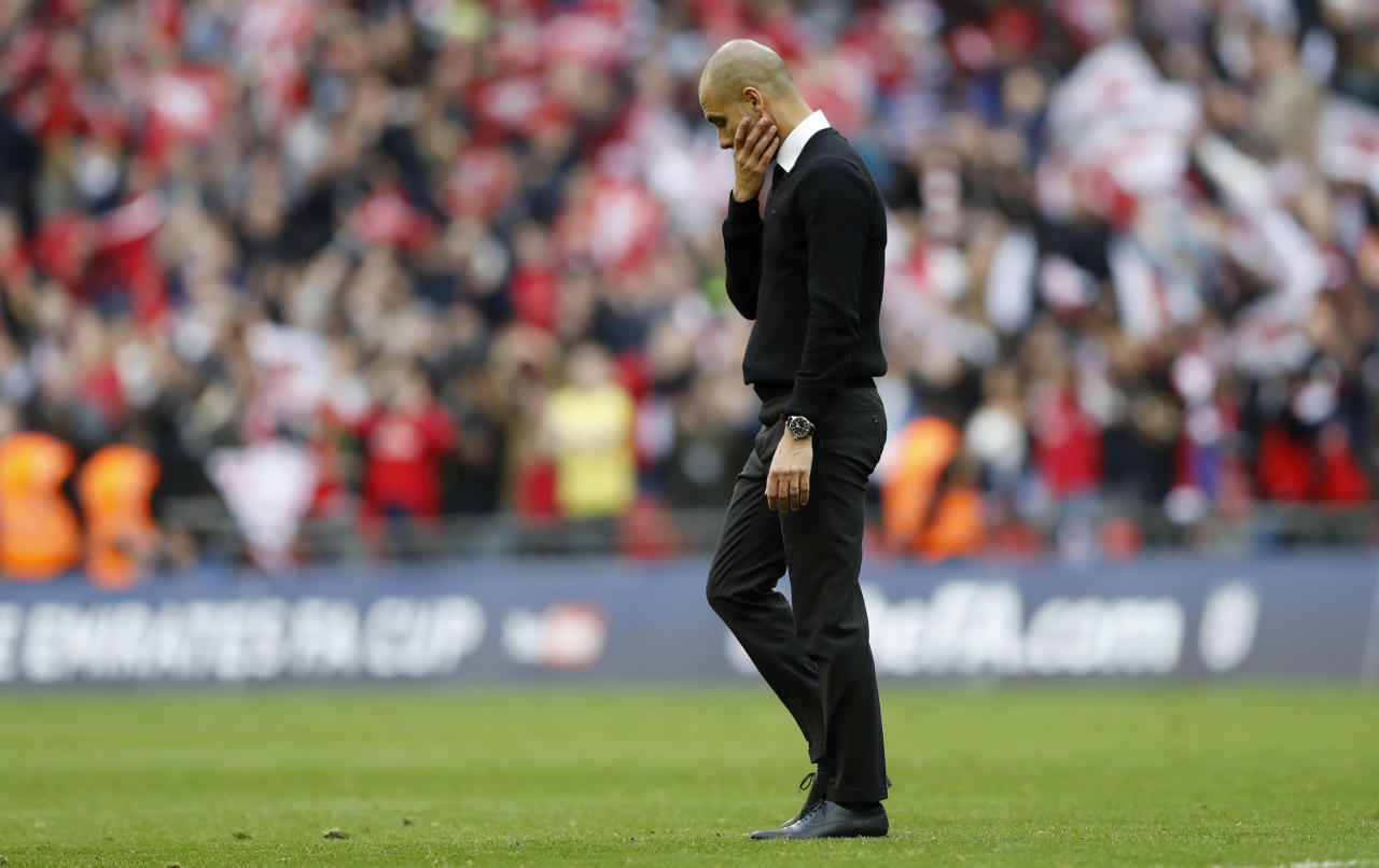"Britain Football Soccer - Arsenal v Manchester City - FA Cup Semi Final - Wembley Stadium - 23/4/17 Manchester City manager Pep Guardiola looks dejected after the match  Action Images via Reuters / Carl Recine Livepic EDITORIAL USE ONLY. No use with unauthorized audio, video, data, fixture lists, club/league logos or ""live"" services. Online in-match use limited to 45 images, no video emulation. No use in betting, games or single club/league/player publications.  Please contact your account representative for further details."