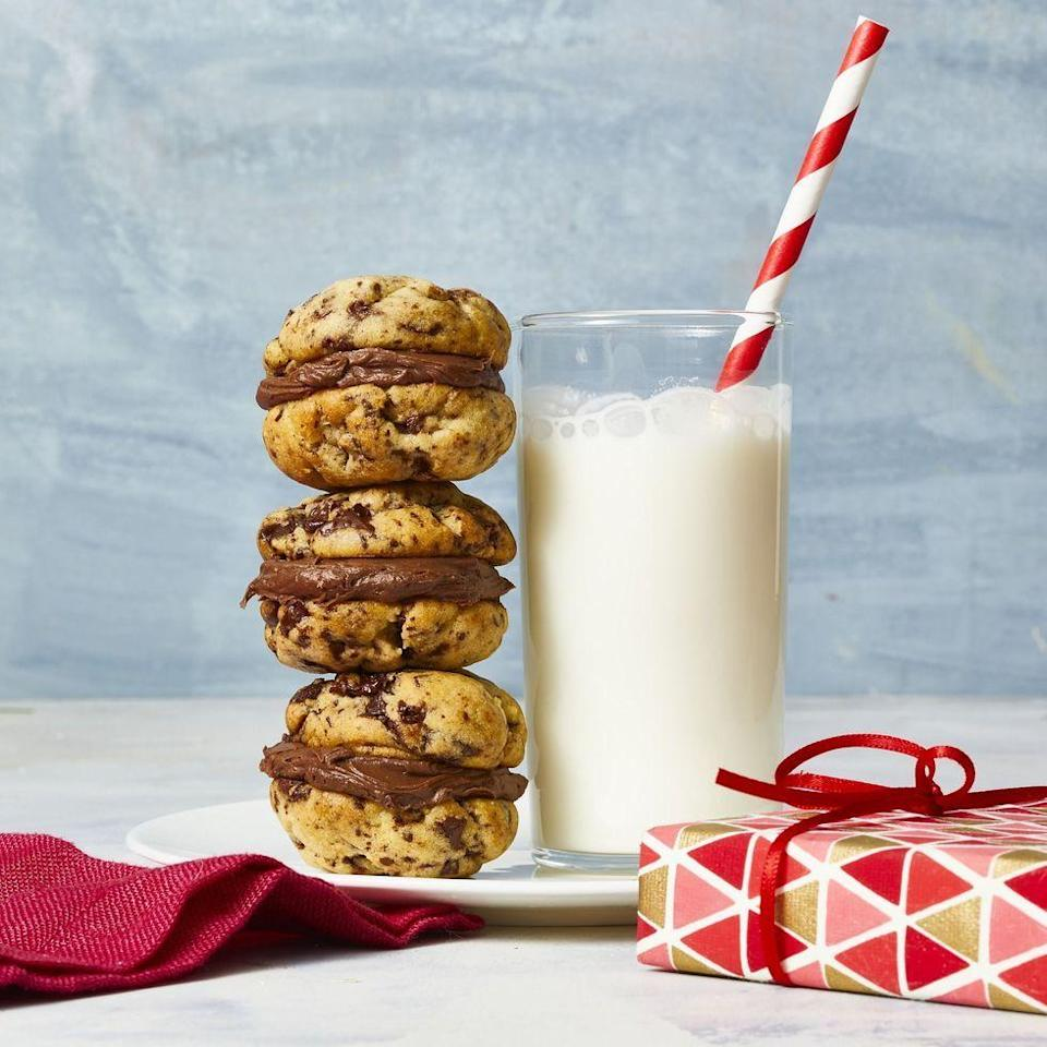 """<p>Classic chocolate chip cookies stuffed with rich chocolate frosting make the ultimate satisfying bite-sized treat.</p><p><em><a href=""""https://www.womansday.com/food-recipes/food-drinks/a29774281/mini-chocolate-chip-sandwiches/"""" rel=""""nofollow noopener"""" target=""""_blank"""" data-ylk=""""slk:Get the recipe from Woman's Day »"""" class=""""link rapid-noclick-resp"""">Get the recipe from Woman's Day »</a></em></p>"""