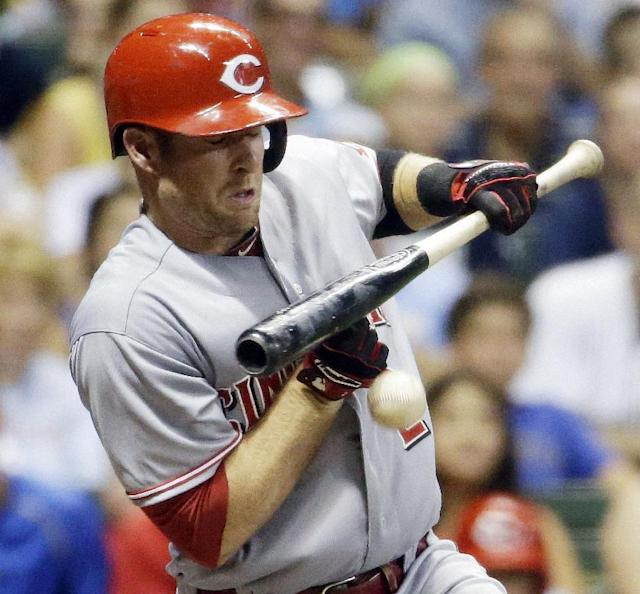 Cincinnati Reds' Zack Cozart is hit by a pitch during the seventh inning of a baseball game against the Milwaukee Brewers, Tuesday, July 22, 2014, in Milwaukee. (AP Photo/Morry Gash)