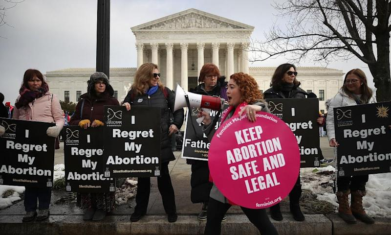 Pro-choice and anti-abortion protesters gather in front of the US supreme court building during the Right to Life march on 18 January, in Washington DC.