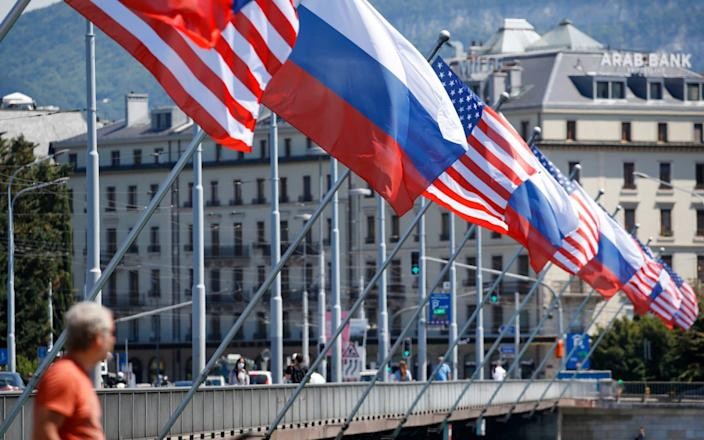 Geneva is preparing to host the summit between Russia and the US on Wednesday by putting up flags around the town - Stefan Wermuth/Bloomberg