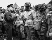 In this June 6, 1944, file photo, U.S. Gen. Dwight D. Eisenhower, left, gives the order of the day to paratroopers in England prior to boarding their planes to participate in the first assault of the Normandy invasion. A dwindling number of D-Day veterans will be on hand in Normandy in June 2019, when international leaders gather to honor them on the invasion's 75th anniversary. (U.S. Army Signal Corps via AP)