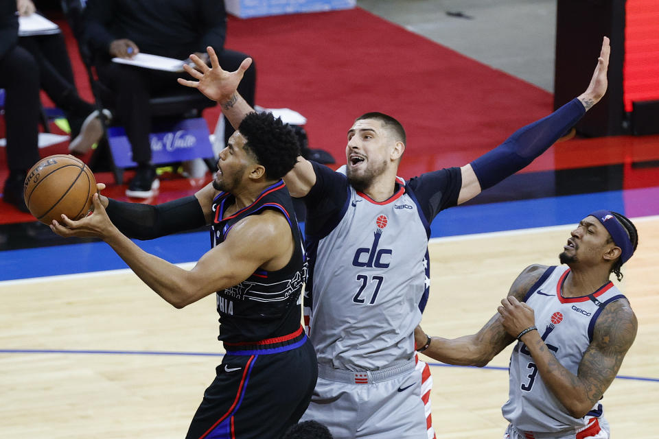 Philadelphia's Tobias Harris shoots under Washington's Alex Len during the first game of the Eastern Conference first-round series at Wells Fargo Center in Philadelphia on May 23, 2021. (Tim Nwachukwu/Getty Images)