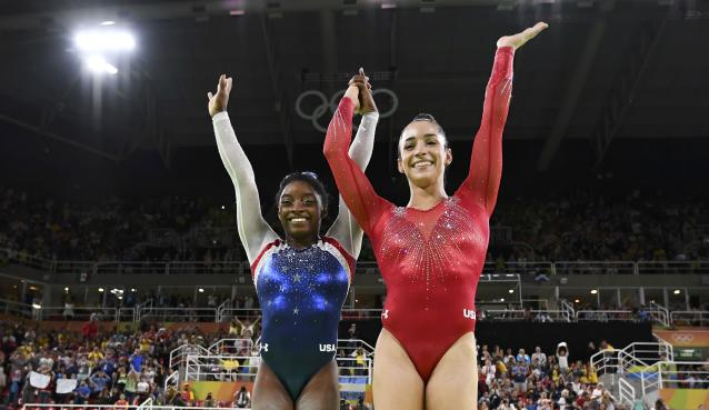 2016 Rio Olympics - Artistic Gymnastics - Final - Women's Individual All-Around Final - Rio Olympic Arena - Rio de Janeiro, Brazil - 11/08/2016. Simone Biles (USA) of USA (L) and Alexandra Raisman (USA) of USA (Aly Raisman) celebrate winning gold and silver respectively at the women's individual all-around final. REUTERS/Dylan Martinez FOR EDITORIAL USE ONLY. NOT FOR SALE FOR MARKETING OR ADVERTISING CAMPAIGNS.