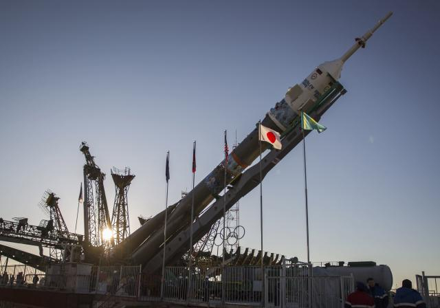 The Soyuz TMA-11M spacecraft decorated with 2014 Sochi Winter Olympic Games' patterns, is lifted on its launch pad at the Baikonur cosmodrome November 5, 2013. The Soyuz spacecraft will carry Japanese astronaut Koichi Wakata, Russian cosmonaut Mikhail Tyurin and U.S. astronaut Rick Mastracchio to the International Space Station (ISS) on November 7. REUTERS/Shamil Zhumatov (KAZAKHSTAN - Tags: SCIENCE TECHNOLOGY)