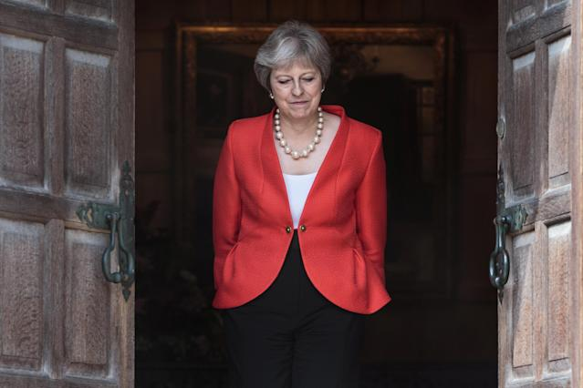 <p>Britain's Prime Minister Theresa May waits to greet President Donald Trump at Chequers near Aylesbury, Britain, July 13, 2018. (Photo: Jack Taylor/Pool via Reuters) </p>