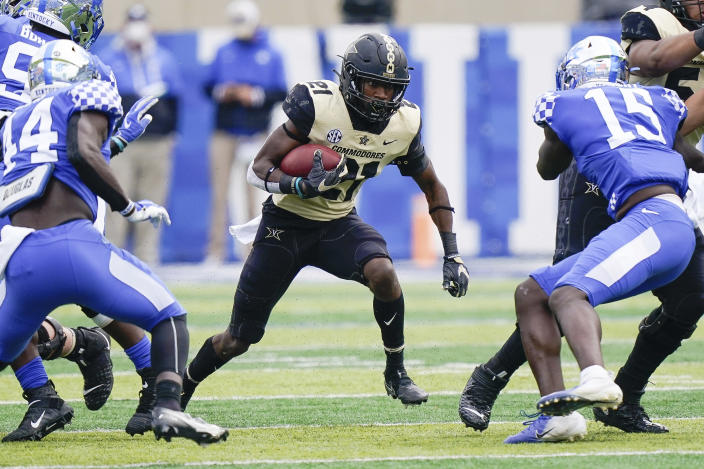 Vanderbilt linebacker Kenny Hebert (21) runs with the ball during the first half of an NCAA college football game against Kentucky, Saturday, Nov. 14, 2020, in Lexington, Ky. (AP Photo/Bryan Woolston)