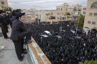 Thousands of ultra-Orthodox Jews participate in funeral for prominent rabbi Meshulam Soloveitchik, in Jerusalem, Sunday, Jan. 31, 2021. The mass ceremony took place despite the country's health regulations banning large public gatherings, during a nationwide lockdown to curb the spread of the coronavirus. (AP Photo/Ariel Schalit)