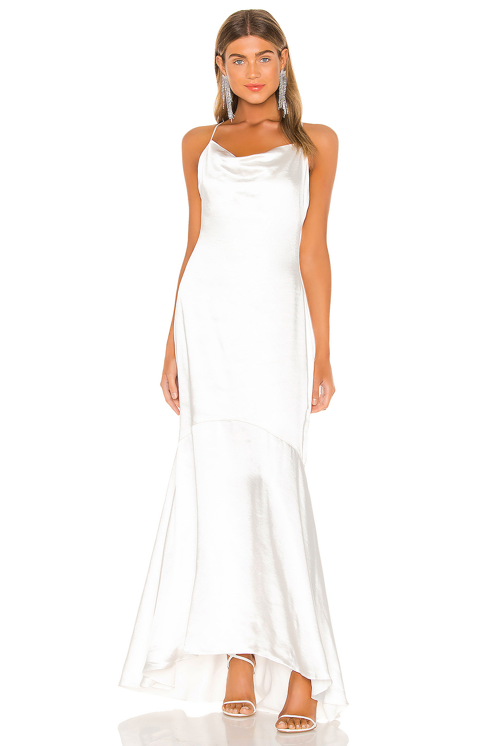 """<h2><a href=""""https://www.revolve.com/wedding/bride/?navsrc=subclothing"""" rel=""""nofollow noopener"""" target=""""_blank"""" data-ylk=""""slk:Revolve"""" class=""""link rapid-noclick-resp"""">Revolve</a></h2><br>If you're a frequent shopper on Revolve, you'll recognize the e-tailer's penchant for sexy, form-fitting, high-slit styles in its bridal edit. For those looking for something more subtle, Revolve also carries brands like LoveShackFancy, known for its sweet, prairie-like dresses."""