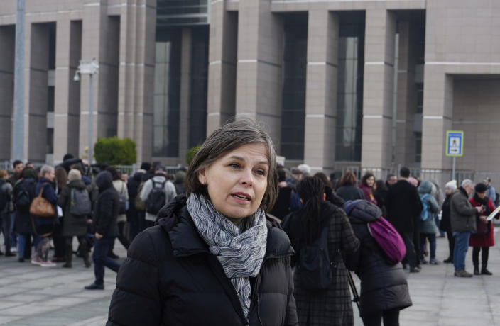 Emma Sinclair Webb, Human Rights Watch Senior Turkey Researcher, speaks to the media before the trial of the Amnesty International's former Turkey chairman and 10 other activists, in Istanbul, Wednesday, Feb. 19. 2020. A court in Istanbul will hand down verdicts for defendants in the closely-watched trial on charges of belonging to or aiding terror groups. The case against activists heightened concerns about Turkey's treatment of human rights defenders. (AP Photo)