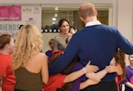 """<p>Poised to be <a href=""""https://www.harpersbazaar.com/celebrity/latest/a19512240/when-will-prince-harry-meghan-markle-have-kids/"""" rel=""""nofollow noopener"""" target=""""_blank"""" data-ylk=""""slk:great dad someday"""" class=""""link rapid-noclick-resp"""">great dad someday</a>, Markle laughed across the room as Prince Harry was bombarded by a swarm of school girls, when the couple attended a street dance class during their visit to Star Hub in Cardiff, Wales. </p>"""