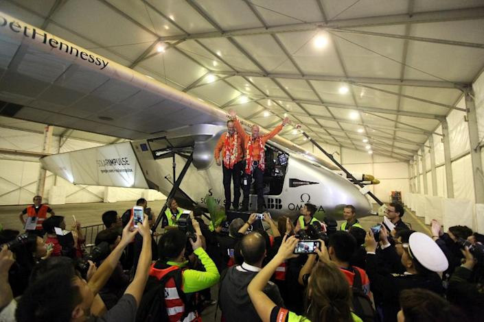 Swiss pilots Andre Borschberg (L) and Bertrand Piccard (R) of Solar Impulse 2, wave to the media after landing in Chongqing airport (AFP Photo/)