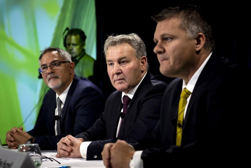Fonterra's Chief Financial officer Marc Rivers, left, Chairman John Monaghan and Chief Executive Miles Hurrell address a press conference following New Zealand's largest company's announcement of an after-tax loss of 196 million New Zealand dollars (US$129 million) in Auckland, New Zealand, Thursday, Sept. 13, 2018. Fonterra, the world's largest exporter of dairy products, said it will completely review its business investments after a disastrous financial year saw it post its first-ever loss.(Dean Purcell/New Zealand Herald via AP)