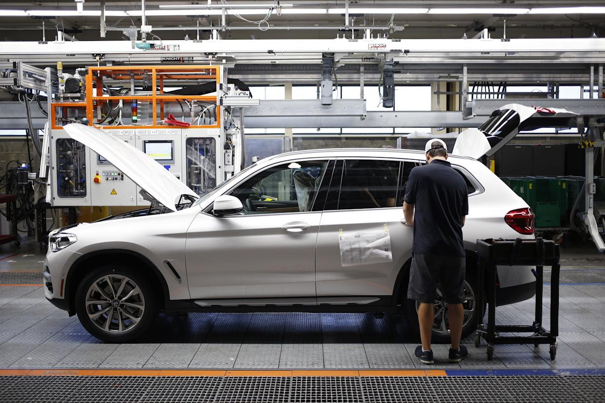 A worker at the BMW Manufacturing Co. plant in Greer, South Carolina, in May. Contradicting President Donald Trump's Nov. 29 claim that it has announced a new plant in the U.S., the automaker said it is only considering opening a second facility. (Photo: Bloomberg via Getty Images)