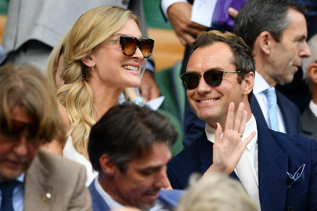 British actor Jude Law (R) and wife Phillipa Coan (L) are seen in the Royal Box above Centre Court before the start of the men's singles semi-final match between Serbia's Novak Djokovic and Spain's Roberto Bautista Agut on day 11 of the 2019 Wimbledon Championships at The All England Lawn Tennis Club in Wimbledon, southwest London, on July 12, 2019. (Photo by Daniel LEAL-OLIVAS / AFP) / RESTRICTED TO EDITORIAL USE        (Photo credit should read DANIEL LEAL-OLIVAS/AFP via Getty Images)