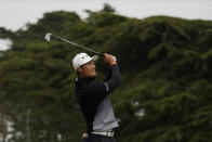 Li Haotong of China, watches his tee shot on the third hole during the third round of the PGA Championship golf tournament at TPC Harding Park Saturday, Aug. 8, 2020, in San Francisco. (AP Photo/Jeff Chiu)