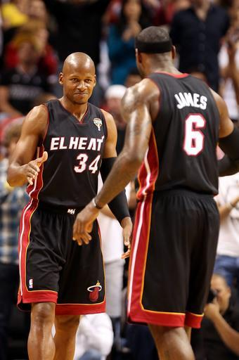 MIAMI, FL - MARCH 08: Guard Ray Allen #34 (L) and Forward LeBron James #6 of the Miami Heat react against the Philadelphia 76ers at American Airlines Arena on March 8, 2013 in Miami, Florida. (Photo by Marc Serota/Getty Images)