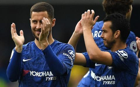 Chelsea's Belgian midfielder Eden Hazard (L) and Chelsea's Spanish midfielder Pedro applauds the fans ahead of the English Premier League football match between Chelsea and Watford at Stamford Bridge in London on May 5, 2019 - Credit: Getty Images