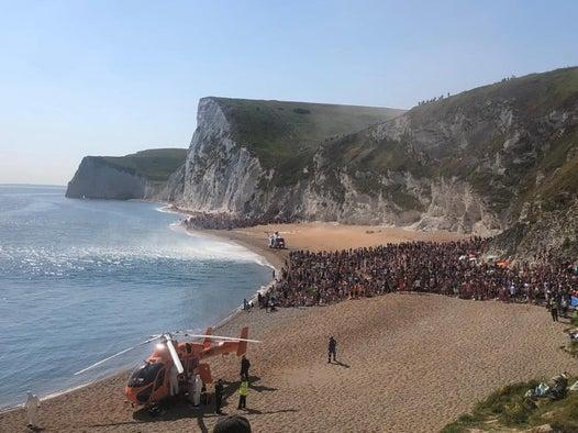Durdle Door: Four injured in 200ft cliff jump, prompting police to close packed beach