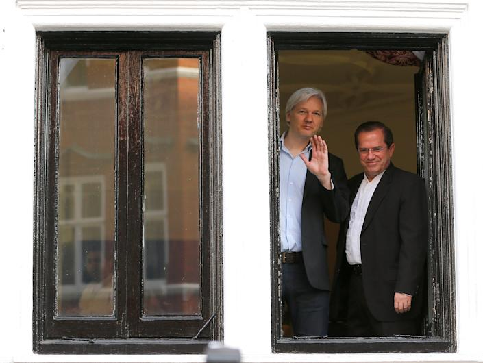 WikiLeaks founder Julian Assange, left, appears with Ecuador's then-Foreign Minister Ricardo Patino on the balcony of the Ecuadorian Embassy in London, Sunday, June 16, 2013.