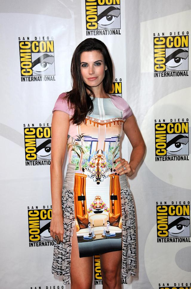 "SAN DIEGO, CA - JULY 18: Actress Meghan Ory speaks onstage at the ""Intelligence"" panel during Comic-Con International 2013 at San Diego Convention Center on July 18, 2013 in San Diego, California. (Photo by Albert L. Ortega/Getty Images)"