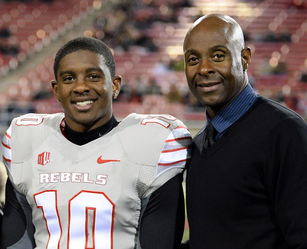 LAS VEGAS, NV - NOVEMBER 30: Jerry Rice Jr. #10 of the UNLV Rebels poses with his father, Hall of Fame National Football League player Jerry Rice, during senior night festivities on the field before UNLV's game against the San Diego State Aztecs at Sam Boyd Stadium on November 30, 2013 in Las Vegas, Nevada. (Photo by Ethan Miller/Getty Images)