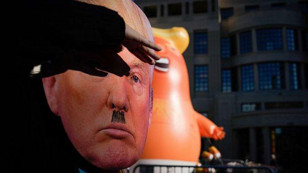 PHOTO: A protester wearing a mask dances near a Baby Trump balloon last week in front of the courthouse on November 4, 2019 in Lexington, Kentucky. (Photo by Bryan Woolston/Getty Images) (Bryan Woolston/Getty Images)