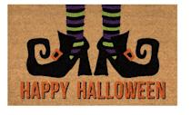 <p>Brush off your shoes in style with this <span>Happy Halloween Witches Feet Door Mat</span> ($11). Its vinyl backing ensures the mat stays secured in place, while its coir-fiber surface blocks dirt from entering your home.</p>
