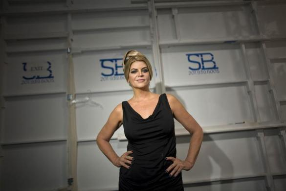 Actress Kirstie Alley poses for a photograph backstage before the Zang Toi Spring/Summer 2012 show during New York Fashion Week September 13, 2011.