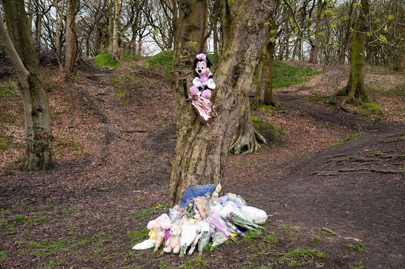 Flowers and toys have been left at the scene (Picture: Caters)
