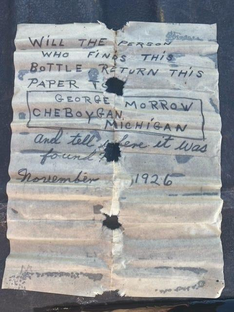 """The letter was inside of the green bottle and read """"Will the person who finds this bottle return this paper to George Morrow Cheboygan, Michigan and tell where it was found?"""""""