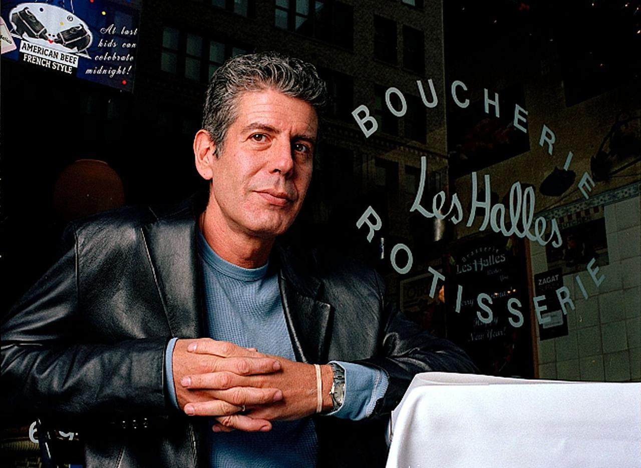 <p>Anthony Bourdain, the executive chef of Les Halles restaurant sits at one of its tables in New York, on Dec. 19, 2001.</p>