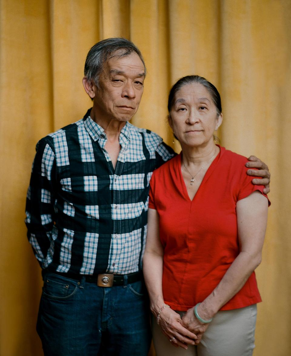 """<strong>'I'M PROUD OF WHAT HE DID.' </strong>Tommy Lau, 63, stands beside his older sister Maggie Wong inside his Brooklyn home on May 22. On March 23, Lau rushed to protect an elderly Asian couple who were being robbed of their groceries—a choice that Wong says reflects her brother's typical boldness. But when Lau intervened, the man spat on his face, punched him on the side of his head and called him a racial slur. Lau has not been able to return to work as a New York City bus driver, because of neck and shoulder injuries he sustained during the attack. Wong, 66, says it's been difficult to watch her brother continue to struggle months later. """"I feel bad,"""" she says, adding that she supports Lau, emotionally and financially, whenever he needs it. """"I'm proud of what he did."""" Meanwhile, despite all that he's endured, Lau doesn't regret getting involved that day. Since immigrating to the U.S. from Hong Kong at age 3, he has long faced racism—his elementary-school classmates bullied him so often about his birth name, Kok Wah Lau, that his teacher changed it to Tommy—and he has had enough. """"The lowest low of people does that, attacking the elderly,"""" he says. """"I just couldn't take it anymore.""""<span class=""""copyright"""">Emanuel Hahn for TIME</span>"""