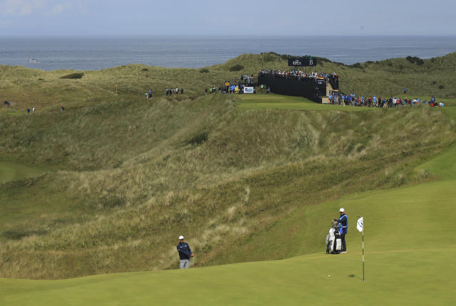 Stewart Cink of the United States looks at his shot that he chipped onto the 16th green during a practice round ahead of the start of the British Open golf championships at Royal Portrush in Northern Ireland, Tuesday, July 16, 2019. The British Open starts Thursday. (AP Photo/Jon Super)
