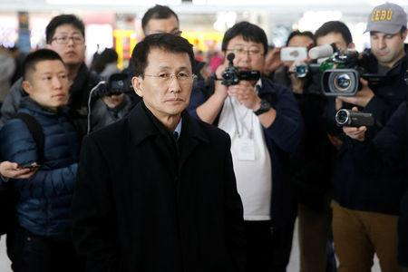 North Korean diplomat Choe Kang Il (C) waits at Capital International Airport to check in to a flight to Helsinki in Beijing, China March 18, 2018.  REUTERS/Thomas Peter