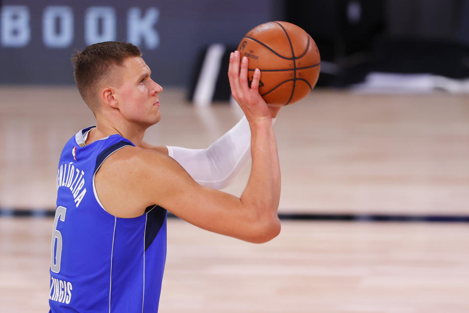 "Kristaps Porzingis will be out until ""at least January,"" according to the Dallas Mavericks. (Mike Ehrmann/Getty Images)"