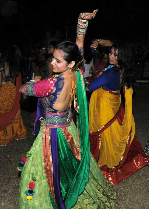 Indian dancers participate in the Friends Cultural Group Garba the Friends Cultural Group Garba on day four of the Navratri festival in Ahmedabad on October 11, 2010. The nine-night festival of worship and dance began on October 8. AFP PHOTO/ Sam PANTHAKY