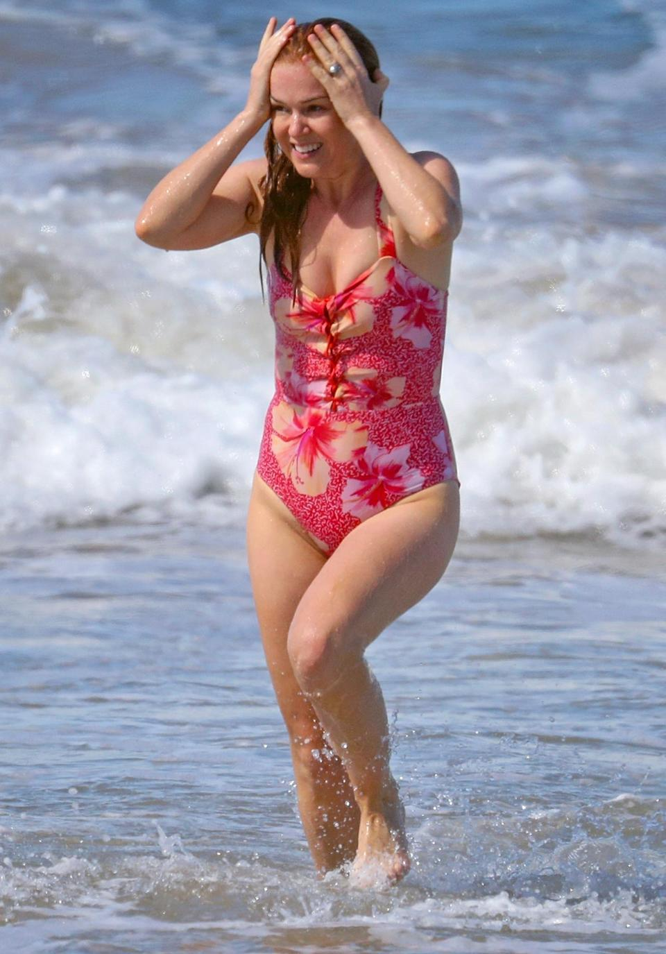 <p>Isla Fisher and husband Sacha Baron Cohen enjoy the beach as they spend time in Sydney, Australia on Tuesday.</p>