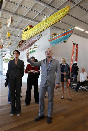 Director Thom Collins (C) speaks during a media tour of the Perez Art Museum Miami (PAMM) in Miami, Florida December 3, 2013. REUTERS/Joe Skipper