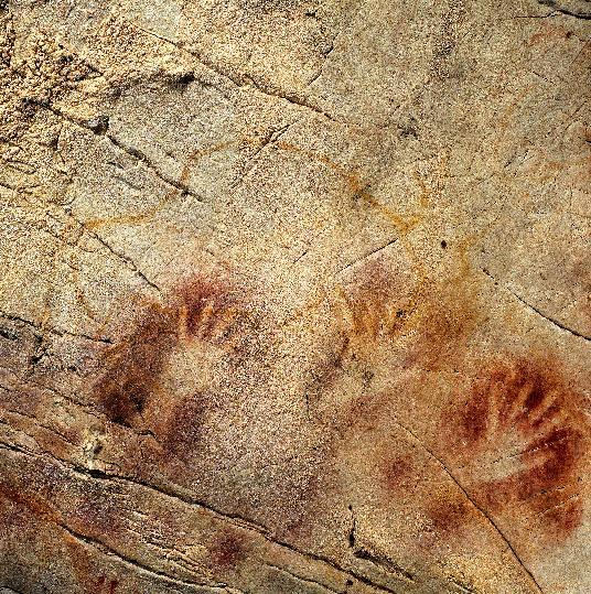 This undated handout photo provided by pedro suara/aaas shows detail of the 'Panel of Hands', El Castillo Cave, Spain, showing red disks and hand stencils made by blowing or spitting paint onto the wall. A date from a disk shows the painting to be older than 40,800 years making it the oldest known cave art in Europe. The bison overlies the hands and is therefore painted later. New tests show that crude Spanish cave paintings of a red sphere and handprints are the oldest in the world, so ancient they may not have been by modern man. They might have even been made by the much-maligned Neanderthals, some scientists suggest but others disagree. (AP Photo/Pedro Saura, AAAS)
